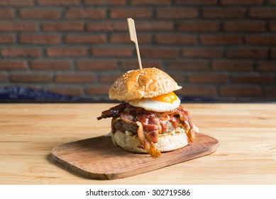 Burgers series : Big bacon and beef steak burger with fried egg
