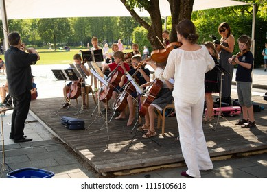 Burghausen,Germany-June 16,2018 : Children in a strings ensemble perform during music school's public concert in a park