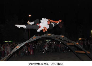 Burghausen,Germany-September 30,2013: Two performance artists balance on top of a bridge during a street show in Burghausen,Germany