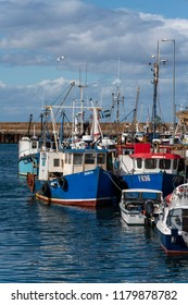 BURGHEAD, MORAY, SCOTLAND - 29 AUGUST 2018: This is view of boats within Burghead Harbour, Moray, Scotland on a very sunny 29 August 2018.