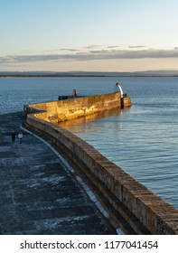 BURGHEAD, MORAY, SCOTLAND - 4 SEPTEMBER 2018: This is a view over the Burghead Harbour Pier on the last of the sun, 4 September 2018.
