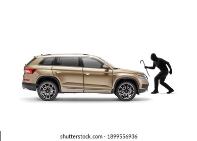 Burglar with a black mask and crowbar walking towards a SUV isolated on white background