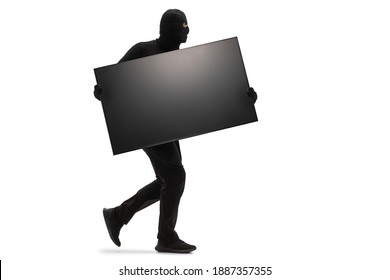Burglar with a black mask stealing a tv and running isolated on white background