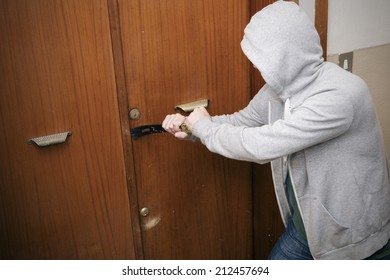 burglar breaking the house door