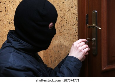 Burglar breaking into house & Door-breaker Images Stock Photos u0026 Vectors | Shutterstock
