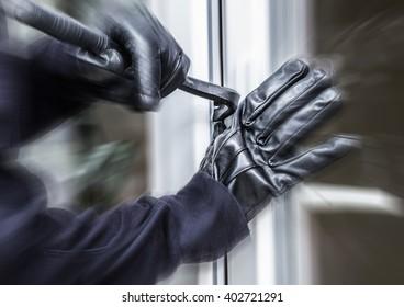 a burglar opens a window