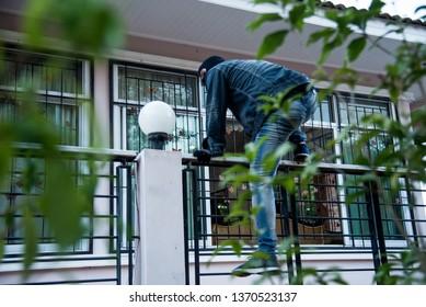 Burglar Robbery or burglary. Climbing the house