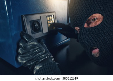 Burglar tries to find the combination code of a safe