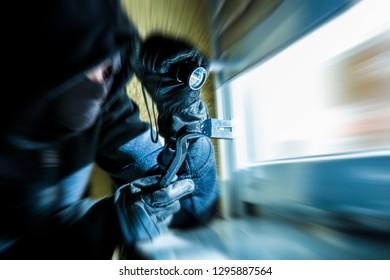 a burglar wants to break into a house