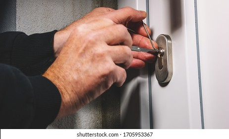 Burglars crack the front door with lock picking