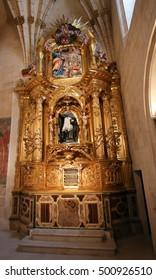 BURGOS, SPAIN - AUGUST 4, 2016: Retable of the Chapel of San Juan de Sahagun in the Gothic Cathedral of Burgos, Castile, Spain.