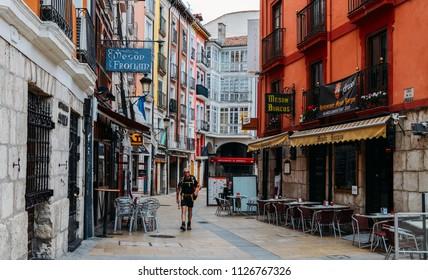 Burgos, Spain - June 13, 2018: Older man on the Camino de Santiago Way of St. James at the historic centre of Burgos, Spain
