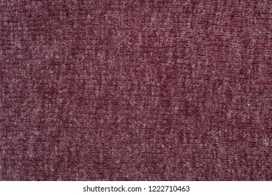 Burgundy knitted fabric. Close up. Fashionable concept