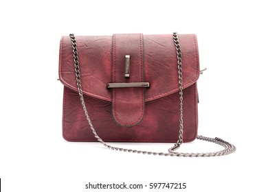 burgundy leather clutch with chain isolated on white