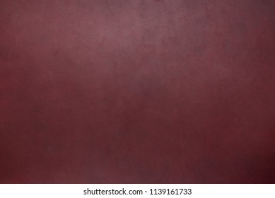 Burgundy, mahogany, maroon, red, brown colored vegetable tanned leather texture background.
