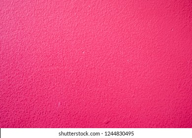 Burgundy red painted wall with texture for background