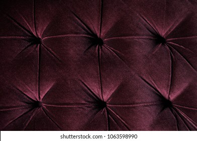 Burgundy Velvet Couch with tufted upholstery, pattern