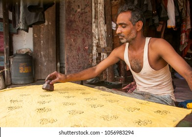 BURHANPUR, MADHYA PRADESH, INDIA 16 NOVEMBER 2016 : Unidentified Indian man making design on fabric at the street.