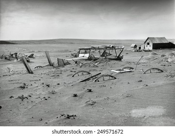 Buried machinery in a barn lot in Dallas, South Dakota in 1936. The Dust Bowl ecological disaster extended from Texas into the Northern Plains and Canada.