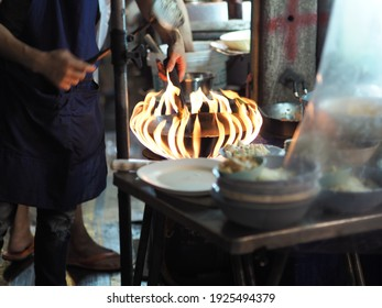 Buring pan with fire flame in the kitchen