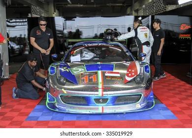 BURIRAM - OCT 25: katoh/Wee with ferrari car parked in the garage during Buriram festival of speed GT Asia series on October 25, 2015 at Chang International Racing Circuit, Buriram Thailand.