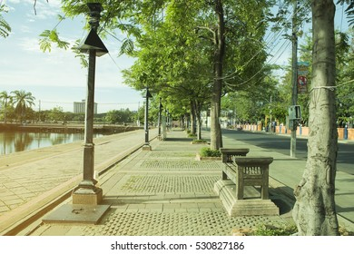 """Buriram, Thailand - June 11,2016: The picture of walks way along the historic city canal """"Khu Muang Alley Lalom"""" and city park direction to the intersection of Rom Buri Road and Jira Road."""