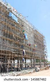 BURIRAM, THAILAND - JUNE 29 : Unidentified workers are working on Taweekit Plaza construction building site on June 29, 2013 in Buriram, Thailand.