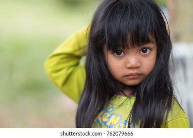 BURIRAM, THAILAND - NOVEMBER 04, 2017 : Portrait of an orphan little girl in the Buriram village, Thailand