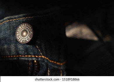 Buriram / Thailand - October 1 2019 : Low key selective focus studs of  Levi's jeans
