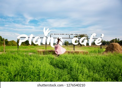 Buriram,Thailand Jan 4, 2018 :Charming Hippie girl  lifestyle concept. Beautiful carefree woman in fields being happy outdoors.Portrait of a beautiful girl in a Bohemian dress in a grass flower field