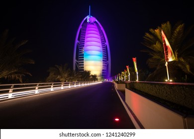 Burj Al Arab hotel night view - front view of luxury 7 stars hotel built on artificial island in front of Jumeirah beach.