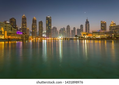 The Burj Khalifa Lake, Downtown skyline and Opera House at dusk, Dubai, United Arab Emirates, Middle East 1-3-2019