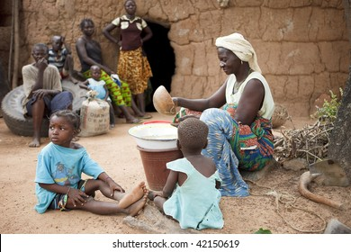 BURKINA FASO - AUGUST 12: Women Lobi separating the grain, women are responsible for handling all foods, August 12, 2009 in Gaoua, Burkina Faso