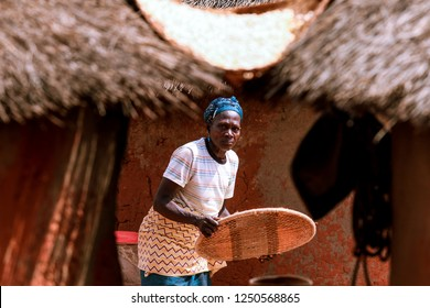 Burkina Faso, Ouagadougou - August 22, 2018: African Woman in the Traditional Clother Working in the Village