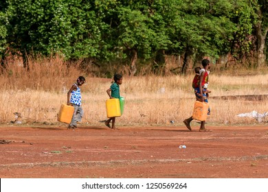 Burkina Faso, Ouagadougou - August 22, 2018: African Women in the Traditional Clother Working in the Village