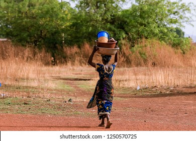 Burkina Faso, Ouagadougou - August 22, 2018: African Woman Working in the Village