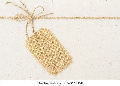 Burlap Cloth Label Tag and Tied Rope Bow over Cardboard Paper, Jute Price Gift Decoration