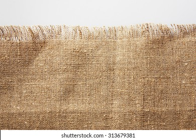 Burlap fabric with frayed edge
