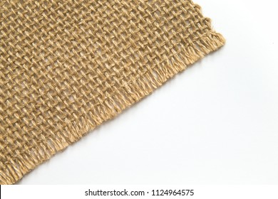 Burlap Fabric on white background. closeup. Sackcloth pattern. natural linen texture.