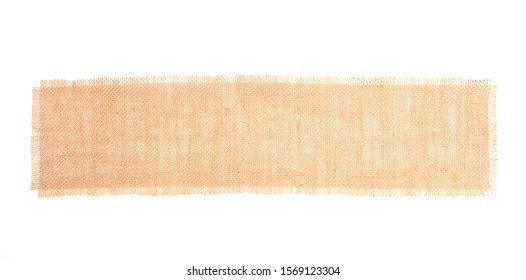 Burlap fabric patch, brown sack cloth label, close up detail of natural material fabric texture for the background