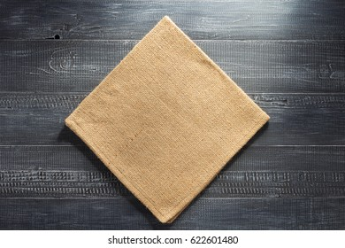 burlap hessian napkin on wooden background