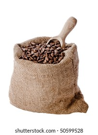 Burlap hessian sack of roasted coffee beans with wooden scoop isolated on white background
