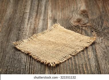 burlap napkin on old wooden table
