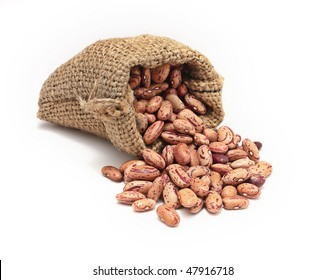 Burlap sack with red beans spilling out over a white background