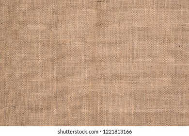 Burlap texture background / Cotton woven fabric background with flecks of varying colors of beige and brown. with copy space. office desk or Dining table concept.