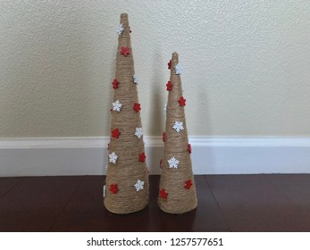 Burlap twine tabletop tree decorations.