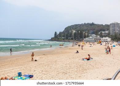 BURLEIGH BEACH, QUEENSLAND, AUSTRALIA - 8th DECEMBER 2019:-Burleigh beach on the Gold Coast, surfing swiming and surf life savers abound.