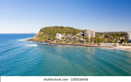 Burleigh heads on the gold coast with nice afternoon sun, gentle waves and beach lifestyle. Aerial view of a favourite holiday destination in Queensland, Australia