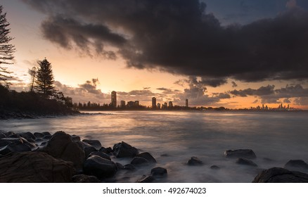 Burleigh Heads on the Rocky Coastline Overlooking the Cityscape of the Gold Coast During a Sunset, Queensland, Australia