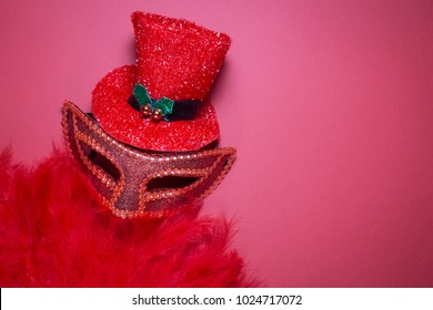 Burlesque cabaret minimal concept with hat, mask, and feather dance fan